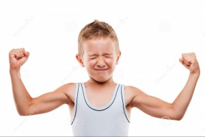 smiling-sport-child-boy-showing-hand-biceps-muscles-strength-beauty-his-white-isolated-32950923
